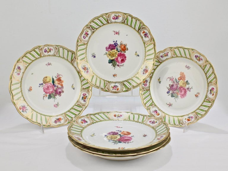 A sophisticated set of 6 antique Vienna porcelain plates.