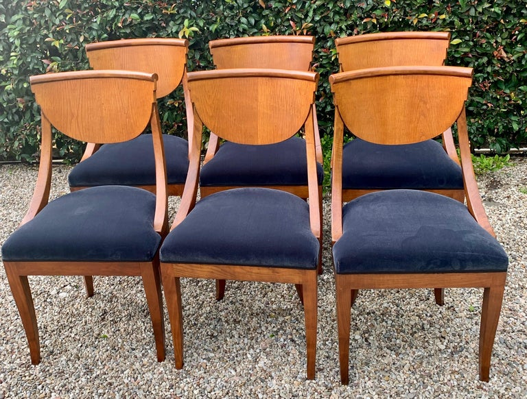 6 handsome satinwood Maple Deco dining chairs. Made in Italy and newly upholstered in a gray / blue Belgian velvet. We added a flat silk satin tuxedo ribbon, taking them from elegant and sophisticated too formal. Wonderful compliment to most dining