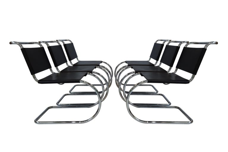 A superb set of 6 black leather and chrome lace back Mies van der Rohe MR10 cantilever chairs produced by Knoll International.     These chairs are a design icon being one of the very first cantilever design chairs ever designed by van der Rohe.