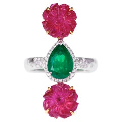 6 Carat Antique Ruby Carving with 1.55 Carat Vivid Green Emerald