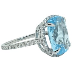 6 Carat Cushion Blue Topaz 18 Karat White Gold 0.38 Carat Diamond Halo Ring