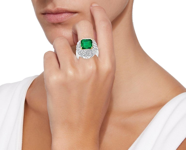 6 Carat Emerald Cut Colombian Emerald and 4 Ct Diamond Ring Platinum, Two-Tone A classic, Cocktail ring  6 Carat  Colombian Emerald Absolutely gorgeous emerald , Very desirable color  Platinum 20 gm  Diamonds: approximate 4 Carat  Emerald: 6