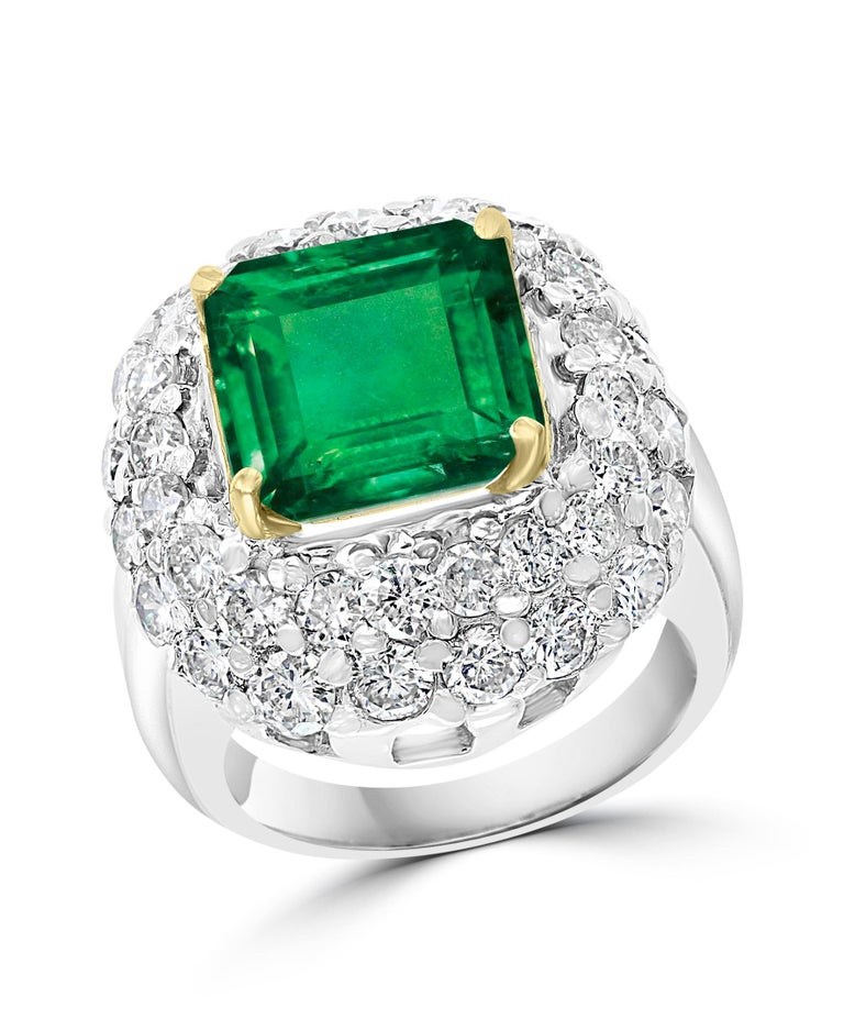 Women's 6 Carat Emerald Cut Colombian Emerald and 4 Carat Diamond Ring Platinum Two-Tone For Sale
