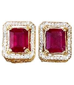 6 Carat Emerald Cut Treated Ruby & .7 Ct Diamond Stud Earrings 14 Kt Yellow Gold