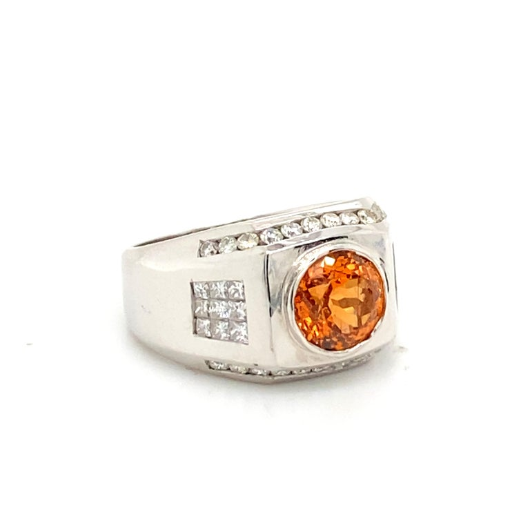 Round Cut 6 Carat Garnet Ring with 2.40 Carats of Diamonds For Sale
