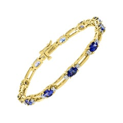 6 Carat Tanzanite and 0.45 Carat Diamond Tennis Bracelet 14 Karat Yellow Gold