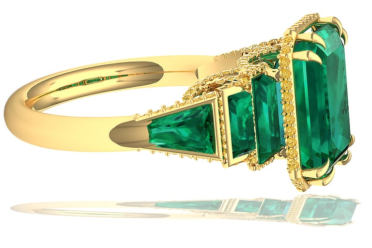 A combination of highly sought after emerald and rich yellow diamond makes this ring one to cherish.  The center stone of this ring is appx 4 carats and is GIA certified with F1 indicating light oiling, often used in emeralds polishing.  The center