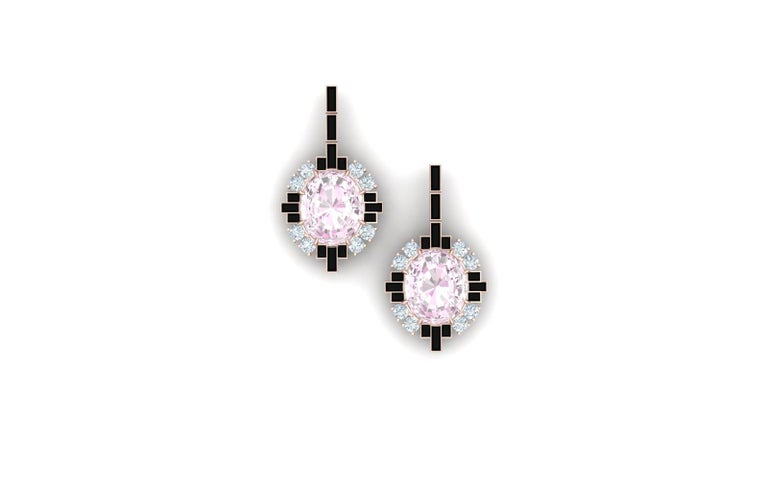 These modern earrings have a the combination of light pastel pink and contrasted with the stark black onyx.  These earrings have a center stone that is oval cut and weighs 1.5 carats each.  The center stone is complemented by 1.2 carats of baguette