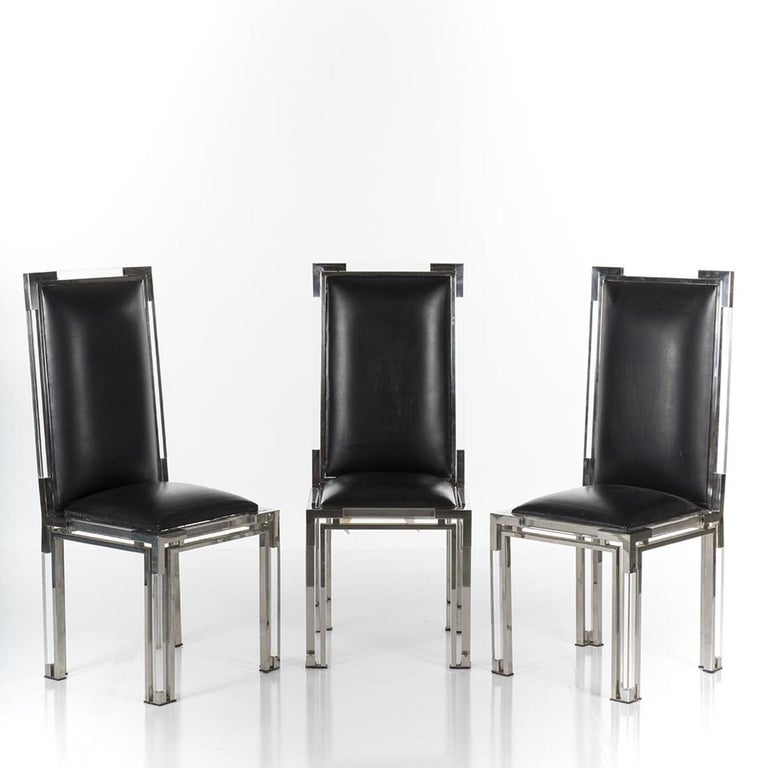 Beautiful set of 6 Lucite and chrome dining chairs from the Metric collection by Charles Hollis Jones 5 upholstered in black vinyl and 1 upholstered in white vinyl.