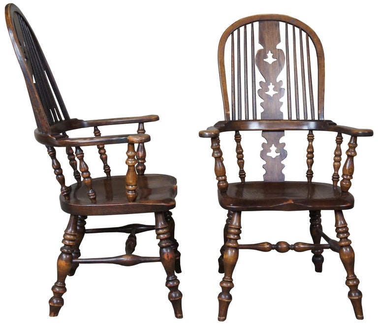 Set of six vintage English Windsor oak dining chairs. Saddle seat and turned baluster supports, circa 1960s-1970s.