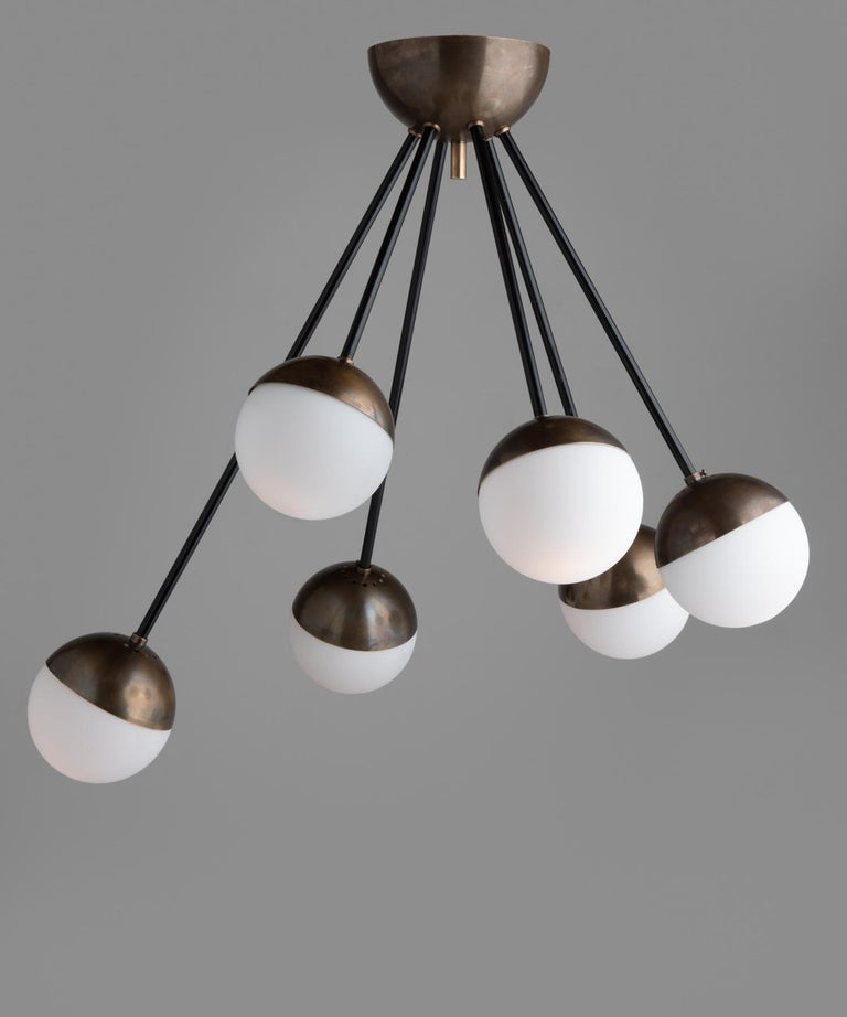 6-globe modern chandelier, Italy, 21st century.  Flush mount brass and steel fixture with six cascading frosted glass globes.
