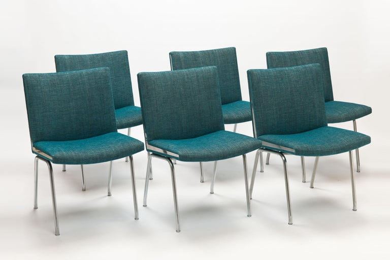 Set of 6 Hans Wegner AP38 'Airport' Chairs by A.P. Stolen, Denmark. Exceptional modern designed chairs on steel frames with sharp triangle shape chrome-plated steel details on both sides of each seat. Designed in 1959. Seats and interiors are fully