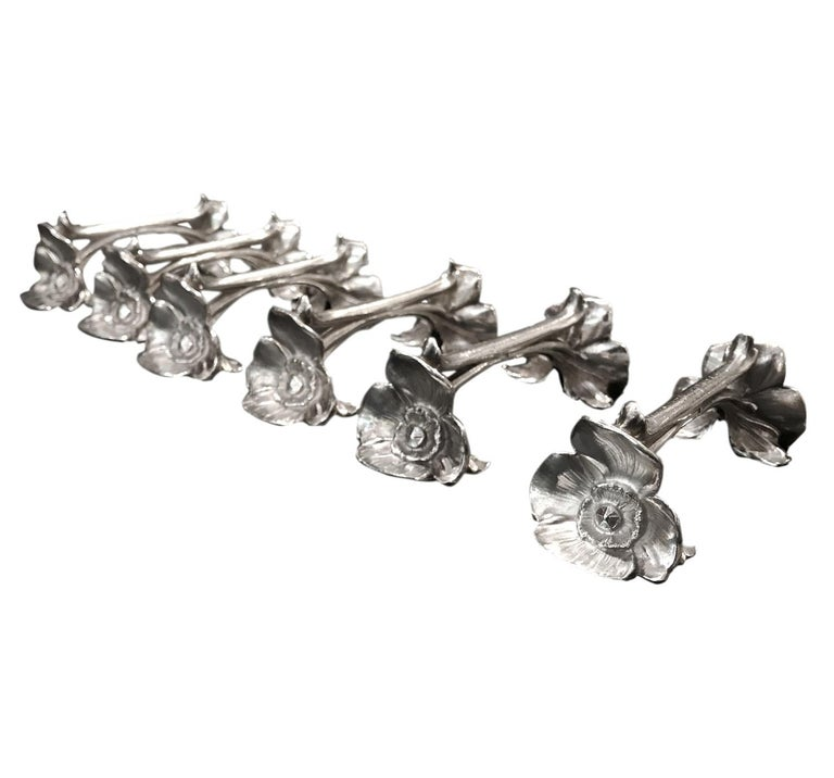 This set of 6 knife-rests with blooming poppy flowers is a very good and typical Art Nouveau design. They are silver-plated, made by Gallia famous french silversmith part of Christofle world well-known. Each one is stamped and signed in the