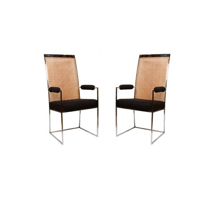 Gorgeous dining chairs designed by Milo Baughman for Thayer Coggin. The simplistic high back chrome frame is softened by the original inset panel of caning. The set consists of four side chairs and two armchairs with upholstered arm rests. Recently