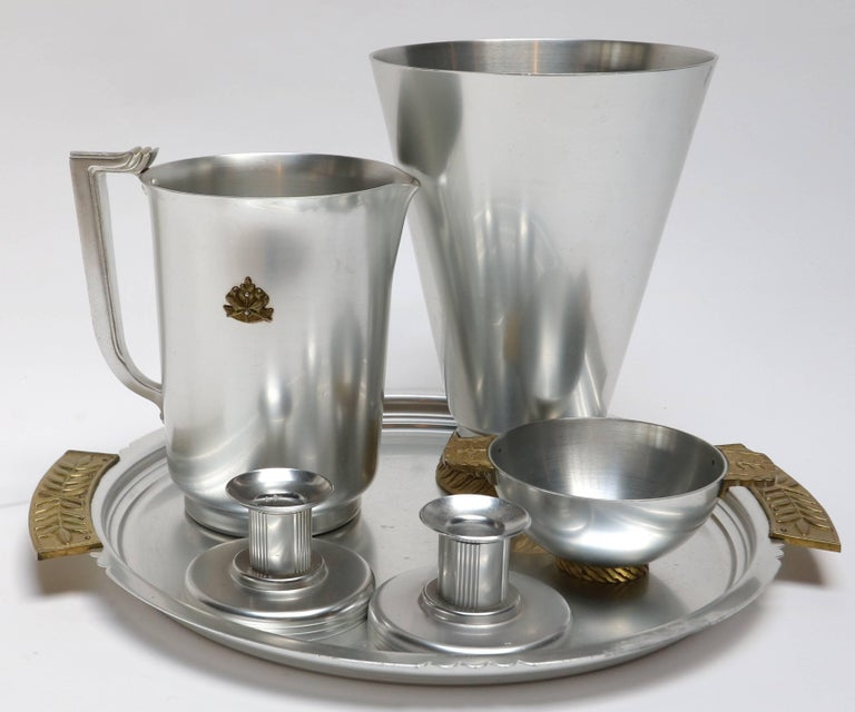 Aluminium and brass pieces table accessories by Kensington, including vase (H x D = 10