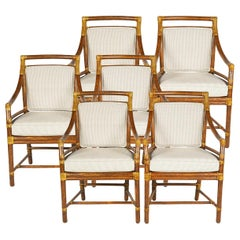 6 Rattan Armchairs with Raw Hide Lace, Cushions and Back Pads by McGuire, 20th C