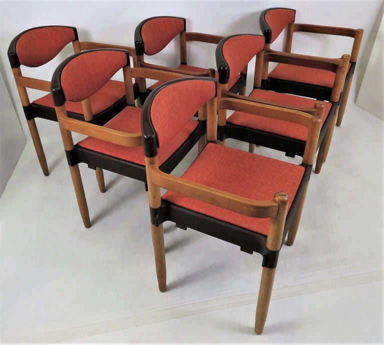 Designed by Harmut Lohmeyer in the 1970s and made by Casala in the late 70s. Called Strax, they are stackable. The seat and back cushions have been re-upholstered, the Beechwood has the original finish with age appropriate wear and finish fading and