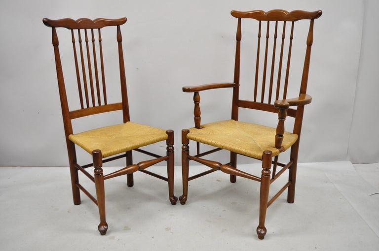 6 vintage spindle back cherrywood rush seat queen Anne Colonial dining chairs. Listing includes woven rush seats, spindle back, stretcher base, 2 armchairs, 4 side chairs, solid wood frame, beautiful wood grain, quality American craftsmanship, great