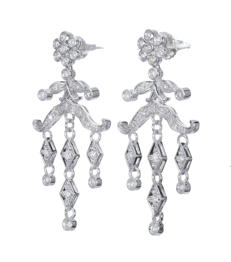 Chandelier style diamond dangle earrings. Set in 14k white gold with a cluster of diamonds at the top, two tiers and  of round accent diamonds.  56 Diamonds approx total weight .60cts Length: 1.65 inches or 41.97mm Width: .82 inches or