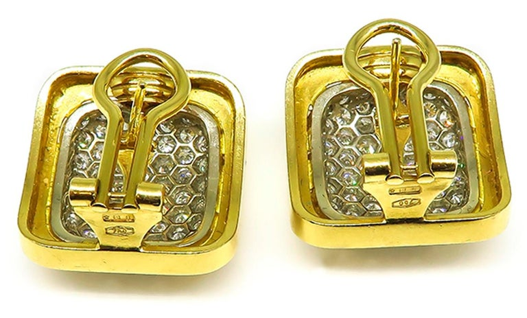 This charming pair of 18k yellow gold earrings feature sparkling round cut diamonds that weigh approximately 6.00ct. graded F-G color with VS clarity. The earrings measure 21mm by 20mm and weigh 20.2 grams. The earrings are stamped 750.   Inventory
