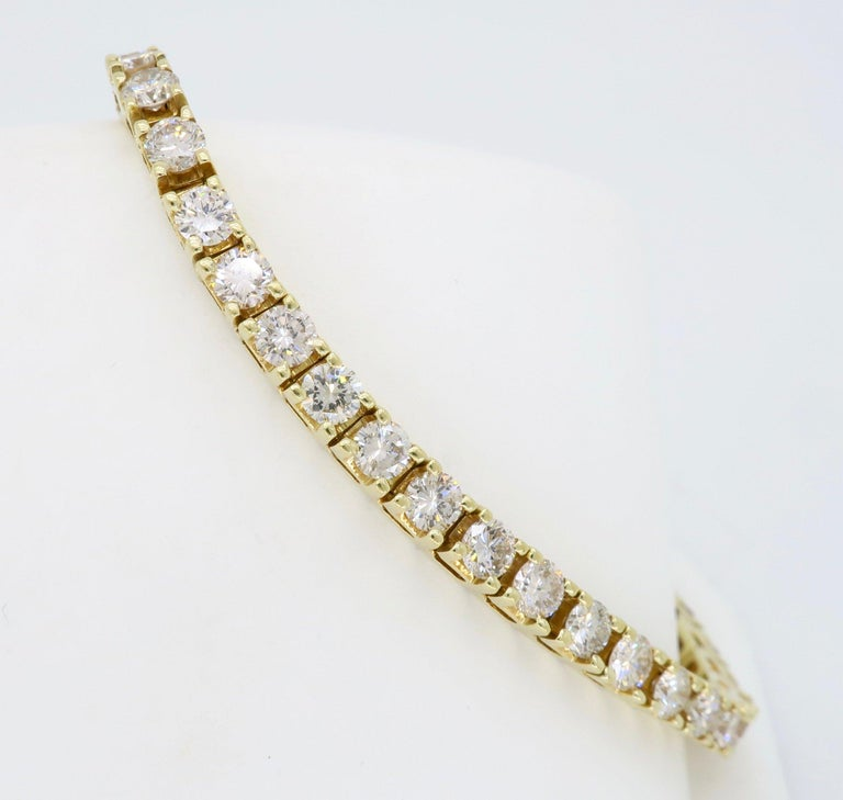 14K yellow gold tennis bracelet mounted with approximately six carats of Round Brilliant Cut diamonds.  Diamond Carat Weight: Approximately 6.00CTW Diamond Cut: 46 Round Brilliant Cut Color: Average I-K Clarity: Average VS-SI Metal: 14K Yellow