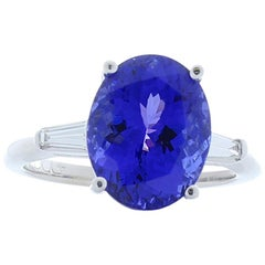 6.00 Carat Oval Tanzanite and Tapered Baguette Diamond White Gold Cocktail Ring