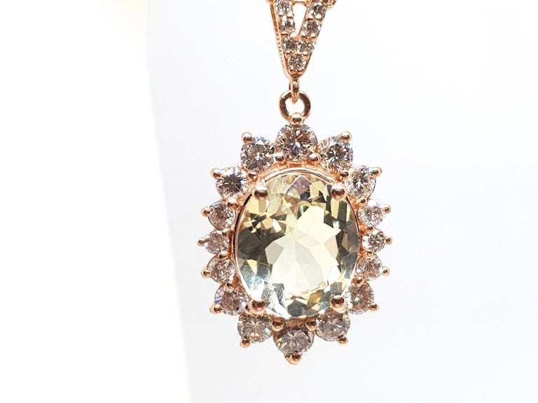 Gold: 18K Rose Gold.  Weight: 5.56 gr.  Diamonds: 1.97ct. Colour: G Clarity: VS  Golden Beryl: 4.03ct.  Length Pendant: 2.5 cm.  Width Pendant: 1.3 cm.  Length Necklace: choose between 40,42,45 or 50cm.  All our jewellery comes with a certificate