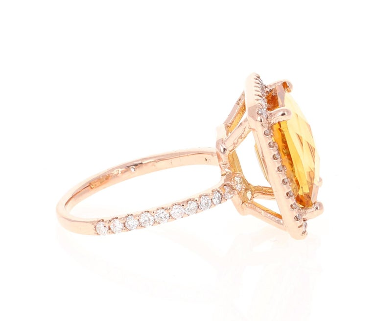 A Stunning beauty to say the least!   This magnificent ring has a bold Emerald Cut Citrine that is blazing yellow! It weighs 5.24 Carats and is surrounded by a beautiful halo of 56 Round Cut Diamonds that weigh 0.79 Carats. (Clarity: SI, Color: F)
