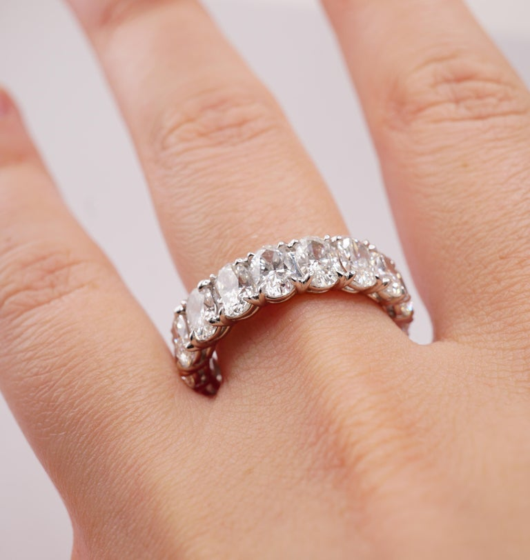 Diamond Eternity Band set in Platinum. Prong set fifteen oval cut diamonds D-F VVS2-VS2. All stones are perfectly matching and at least 6mm long. Polish is from Excellent to Very Good. Carat weight = 6.04 ct. Every stone is GIA-certified. Total ring