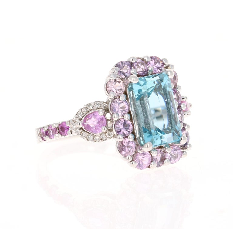 This ring has a gorgeous 3.60 Carat Emerald Cut Aquamarine and is surrounded by Pear Cut Pink Sapphires  that weigh 0.43 Carats. Also an additional 20 Pink Sapphires that weigh 1.90 carats. It is further embellished with 26 Round Cut Diamonds that