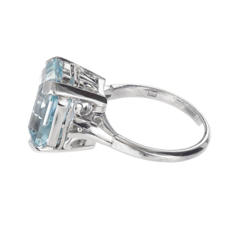 Handmade Art Deco 6.50ct Aqua pierced platinum engagement ring. ring. circa 1940-1950.  1 Emerald cut bright greenish blue Aquamarine, approx. total weight 6.05cts, VS, 13.4 x 10.1mm, natural color and no enhancements Size 6.25 and