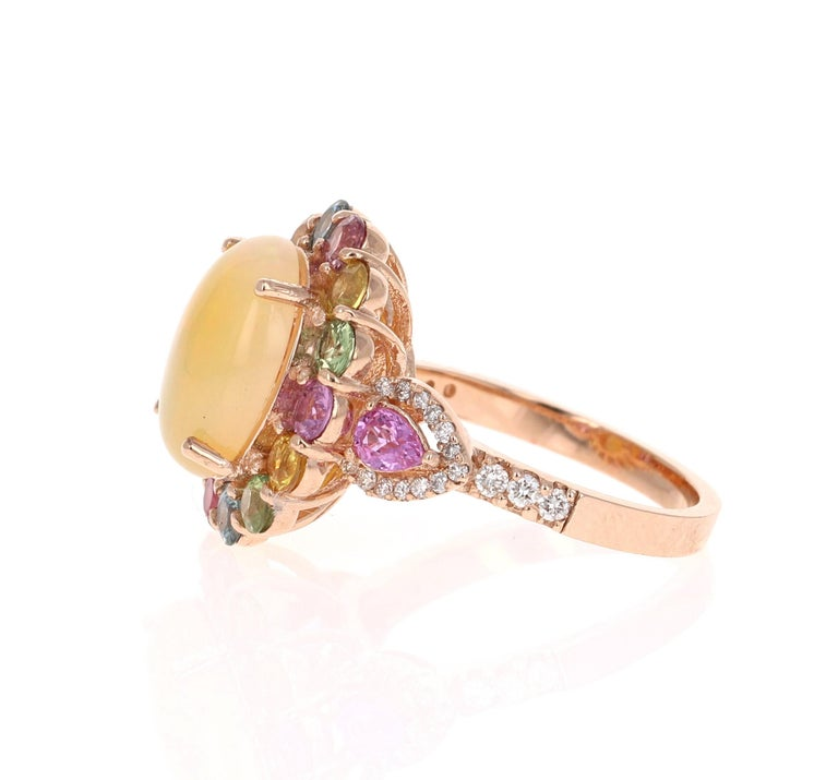 Oval Cut 6.05 Carat Opal Sapphire Diamond 14 Karat Rose Gold Cocktail Ring For Sale