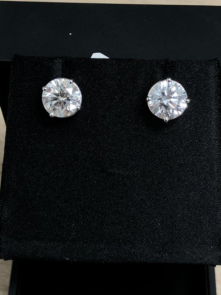 18K White gold Diamond stud earrings, set in a four prong mouting The total diamond weight is 6.05 Carats. Ideal cut diamonds  Near colorless white slightly included. 100% eye clean (H-I SI) Certified by AAA Gemological appraisal laboratory