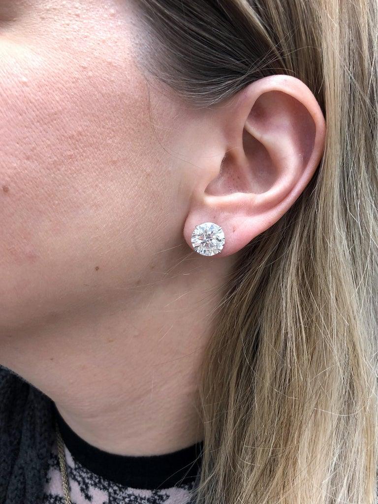 Round Cut 6.05 Carat Diamond Stud Earrings For Sale