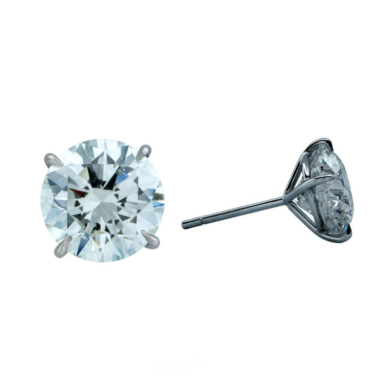 Stunning platinum hand-made solitaire stud earrings featuring two round brilliant cut diamonds weighing 6.12cts total, J color SI2 clarity GIA. Both diamond have excellent, polish, symmetry and cut grade.  Our pieces are all accompanied by an