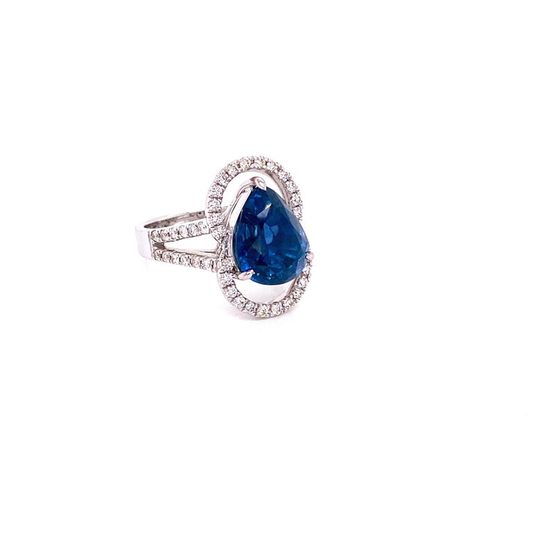 6.07 Carat GRS Certified Unheated Burmese Sapphire and Diamond Engagement Ring:  A rare and elegant ring, it features a beautiful GRS certified unheated Burmese pear-shaped blue sapphire weighing 6.07 carat, surrounded by white round brilliant