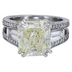 6.07 Carat Radiant Cut Yellow Diamond Three-Stone Engagement Ring
