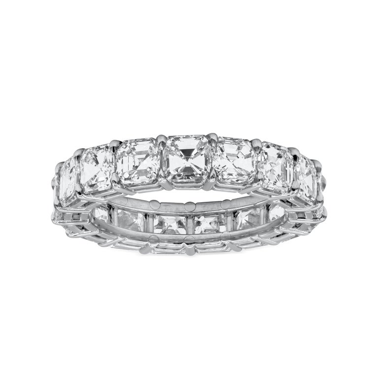 Features a row of asscher cut diamonds set in a shared-prong, open gallery setting made in platinum. Diamonds weigh 6.08 carats total. Size 6.75 US.  Style available in different price ranges. Prices are based on your selection of the 4C's (Carat,