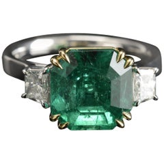 6.08 Carat Colombian Emerald Cut Emerald and Diamond Three-Stone Ring