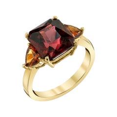 6.09 Carat Emerald Cut Red Garnet and Spessartite Yellow Gold 3-Stone Ring