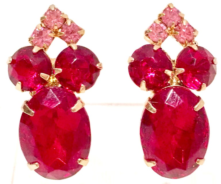 1960'S Gold Plate & Brilliant Ruby And Pink Sapphire Swarovski Crystal Earrings. Features prong set stones with a large oval center stone, round and diamond shape smaller stones. Center stone is approximately, 1