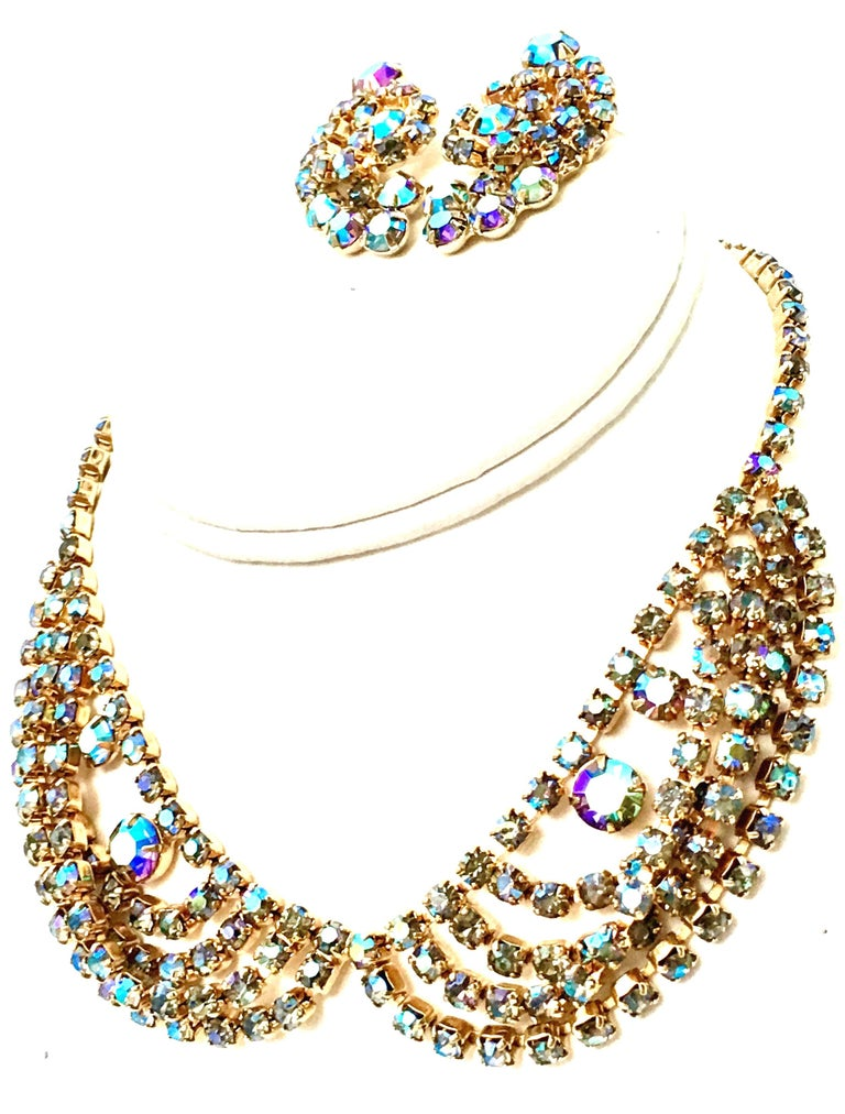 1960'S Gold Plate & Aurora Borealis Swarovski Crystal Necklace & Earrings, Three Piece Set By, Alice Caviness. The lovely swag bib choker style necklace features prong set aurora borealis Swarovski crystal rhinestone set in gold plate with a jeweled