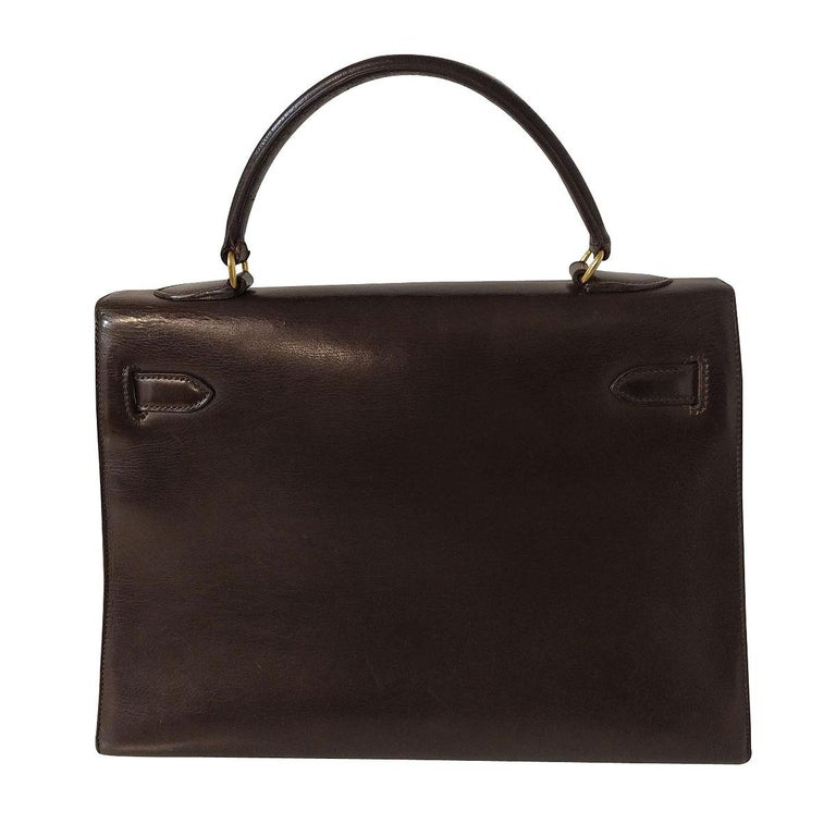 Super iconic and beautiful Hermès bag Kelly 32 Vintage from '60 Leather Dark brown color Single handle Golden hardware Comes with original locker and keys Very good conditions (very light signs due to time, as in pictures) Little unstitching on the