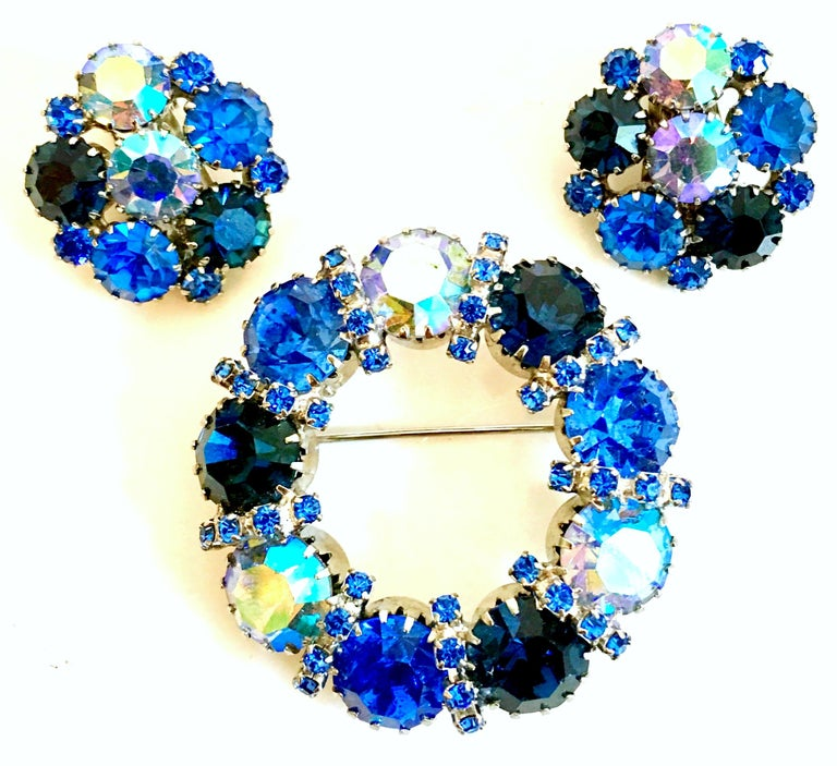 1960'S Weiss Style Silver & Swarovski Crystal Rhinestone Brooch & Earrings Set Of Three Pieces. Features rhodium plate silver with brilliant Blue Sapphire and Aurora Borealis cut and faceted dog tooth prong set stones. The clip style earrings