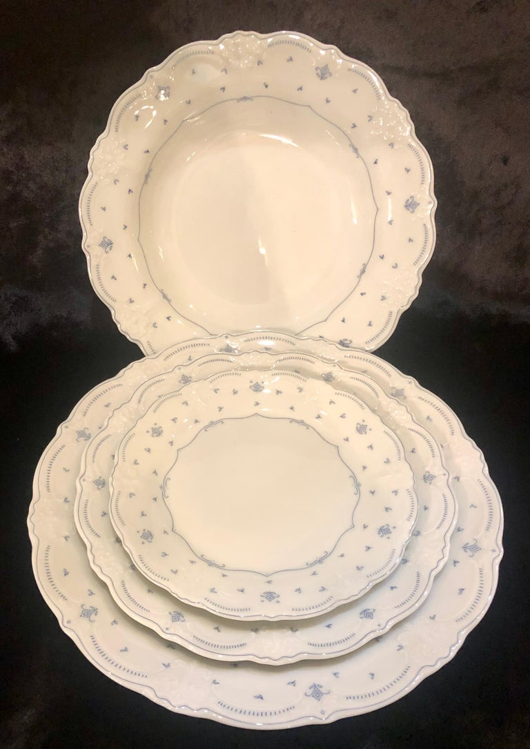 61 pieces Hutschenreuther Porcelain dinner set, Germany, 1814. Fleur De Lis Blue by Tirschenreuth in a bone white and celeste blue finish. This impossible to find dinner set is in lovely condition and ready to impress in any setting. Complete