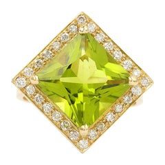 6.13 Carat Peridot 0.50 Carat Diamonds 18 Carat Yellow Gold Ring