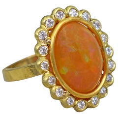 6.14 Carat Ethiopian Opal 22 Karat Gold Diamond Halo Cocktail Ring