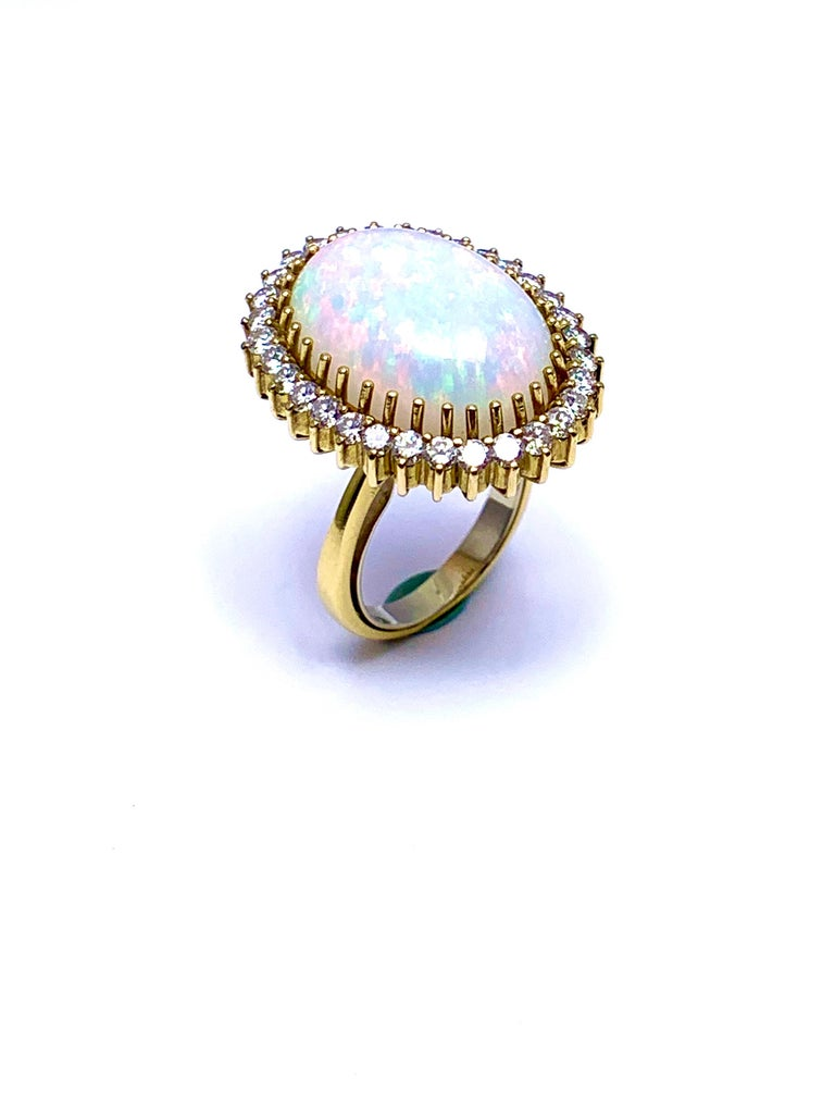 Retro 6.16 Carat Oval Cabochon Opal and Diamond 18 Karat Cocktail Ring For Sale