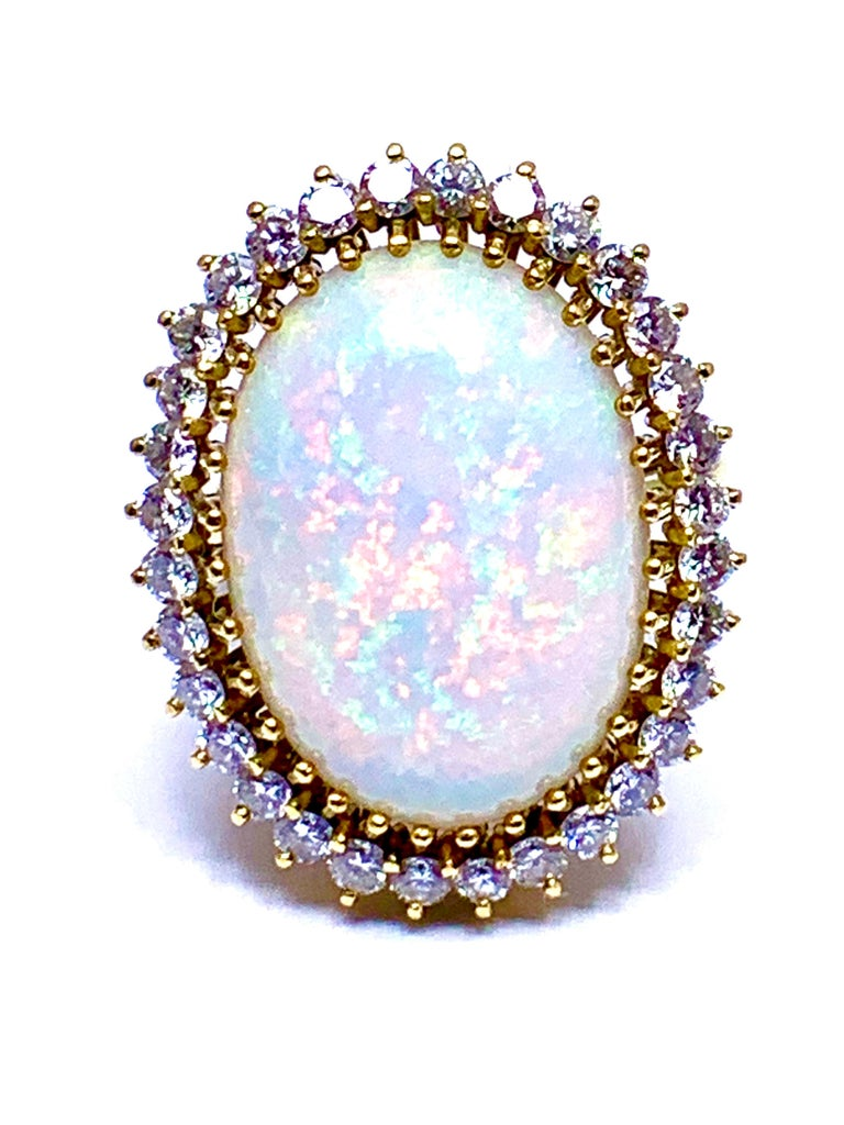 Oval Cut 6.16 Carat Oval Cabochon Opal and Diamond 18 Karat Cocktail Ring For Sale