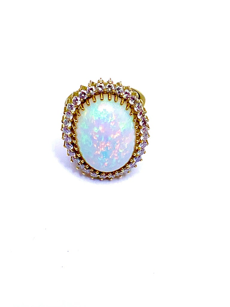 6.16 Carat Oval Cabochon Opal and Diamond 18 Karat Cocktail Ring In Excellent Condition For Sale In Washington, DC